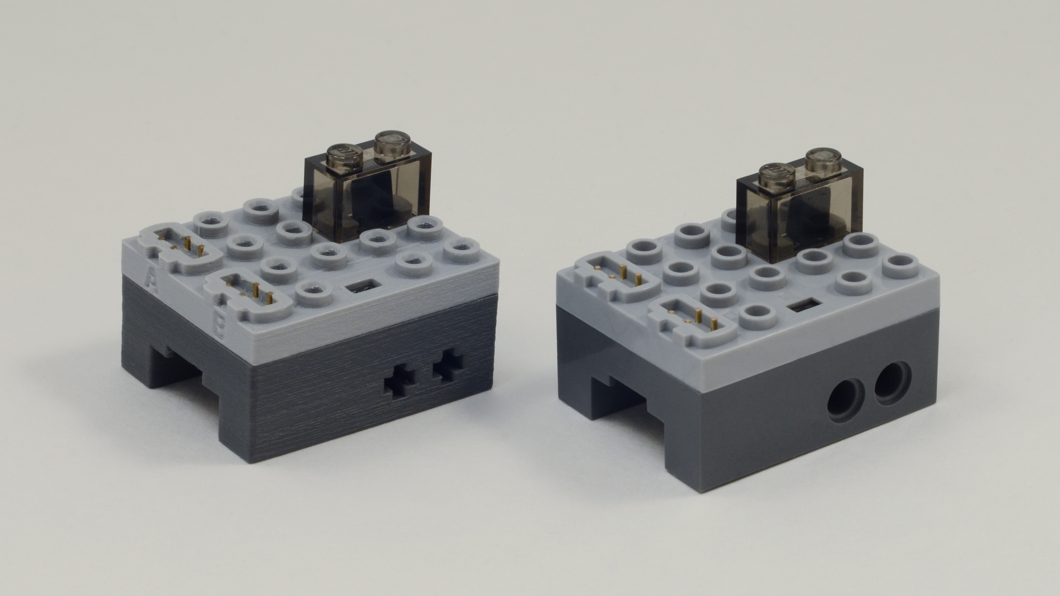 1st generation 3D printed PFx Brick (left) new 2nd generation PFx Brick (right) injected molded in ABS