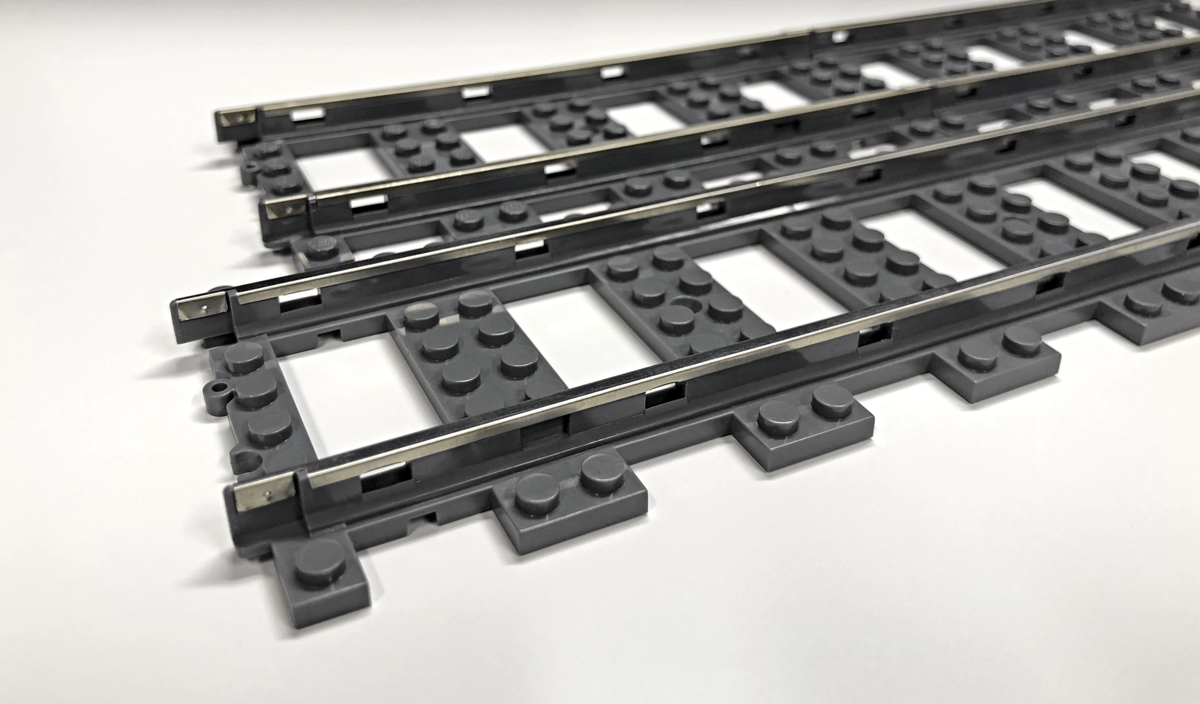 Pre-product S32 straight track (front), LEGO® 9V straight tracks (back)